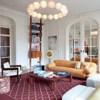 Another view of @sandrabenhamou apartment in Paris out in @vogueliving I love the armchairs by Sergio Rodrigues and Pierre Paulin; the amazing bookcase by Franco Albini; marble side tables by Pierre Gonalons @pierregonalons and the masterpiece : Le Sfere chandelier by Gino Sarfatti; Does Marilyn Monroe Make You Cry? artwork by Louise Lawler and artwork by Meredyth Spark